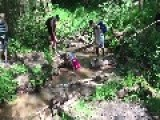 Girl Takes Unexpected Dip In Creek