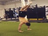 Guy Alternates Hands While Doing Handstand