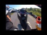 Guy Doing A Wheelie Crashes Into Another Biker