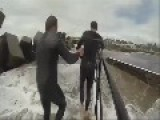 Huge Waves Hit Guys On Breakwater