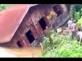 House Falls Into River During Myanmar Floods