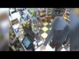 Hooded Thug Waving Gun Raids Shop And Runs Off With £500 In This Terrifying CCTV Footage