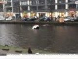 HEROES RESCUE MOM, KID AFTER CAR CRASHES INTO AMSTERDAM CANAL