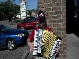 Italian Papa John's Employee Playing The Accordion In Front Of Store