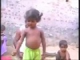 Indian Kid Playing With Cobra Snake