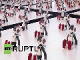 Japan: Watch 100 Mini Breakdancing Robots Perform Flawless Routine