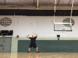 Juggler Tosses Up Five Balls With A Spin