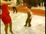 Kid Owns Dance Floor With Hottie In Red