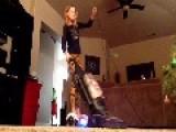 Kid Vacuums On Hoverboard