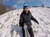 Kid Tumbles Down Snowy Hill