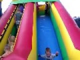 Kids Play On Bouncing Slide