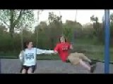 Kid Loses Shorts In Swing Accident