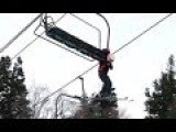 Kid Dangles By His Back Pack From Ski Lift