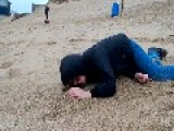 Kid Faceplants On Sand Dune