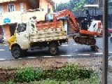 Loading An Excavator Onto A Truck This Happened In Pathanamthitta, India On 14th July 2014