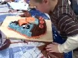 Little Boy Smashes Face Into Birthday Cake