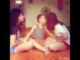 Little Boy Kissing Two Girls