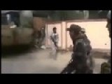 Libyan Rebel Wears Roller Blades In Firefight