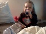 Little Girl Loves To Play The Harmonica