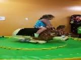 Little Girl Rides Mechanical Bull