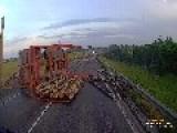 Lumber Truck Spills Logs Onto Highway