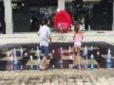 Little Girl Slips In Fountain