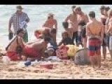 Lifeguards And Professional Surfer Jamie O'Brien Saving An Unconscious Man From The Surf