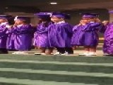 Little Boy Falls Over During Graduation