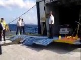 Loading Cars Onto A Ferry During Rough Seas