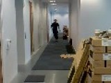 Man Tries To Slide Across Tiles In Office Hallway