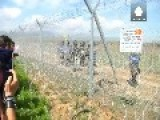 Migrants Break Through Fence On FYROM Border