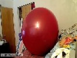 Man Pops Giant Balloon On Bed
