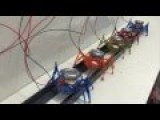 Modeled After Ants, Teams Of Tiny Robots Can Move 2-Ton Car