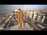 Man Rides Hoverboard On Edge Of Sky Scraper