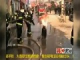 Moment Chinese Firefighter CARRIES Flaming Propane Tank