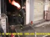 Man Carries Flaming Gas Cylinder Out Of Burning Kitchen
