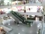 Man Saves A Child From Falling Off An Escalator