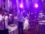Man Tackles Tall Wedding Cake
