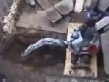 Mini Excavator Driver Battles With Gravity
