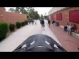 Motorcyclist Films Themselves Riding Through A High School, Barely Missing Kids