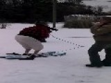 Mother Falls Over On Skis