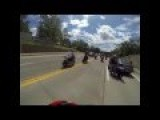 Motorcyclist Runs Into Cop, Motorcycle Stunt Rider Hits Police Car While Doing A Wheelie!