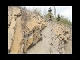 Mountain Bike Rides Down A Cliff