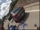 Motorcycle Wheelies Into A Squad Car