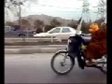 Mullah Self-Flogging While Riding Motorcycle