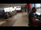 Man Entertains People At The Airport With Great Piano Skills!