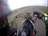 Motorcyclist Hits Helmet On Front Wheel
