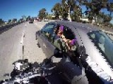 Motorcyclist Grabs Feet On The Freeway