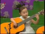 North Korean Children Playing The Guitar