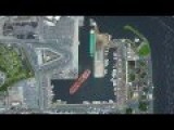 Oil Tanker Docking In A Narrow Port Overhead View